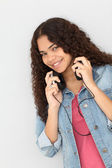 Portrait of smiling teenager listening to music — Stock Photo