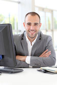 Portrait of satisfied businessman in office — Stock Photo
