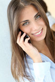 Portrait of beautiful woman talking on mobile phone — Stock Photo