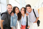 Portrait of cheerful college students — Stock Photo