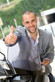 Man going to work on motorcycle — Stock Photo