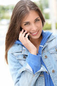 Portrait of young girl using smartphone — Stock Photo