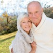 Closeup of senior couple in countryside - 