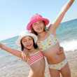 Happy little girls at the beach — Stock Photo