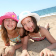Stock Photo: Happy little girls at the beach