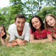 Portrait of happy family in countryside — Stock Photo