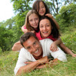 Stock Photo: Portrait of happy family in countryside
