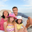 Portrait of family at the beach — Stock Photo