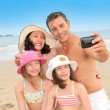 Family taking picture of themselves at the beach — Stock Photo