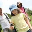Stock Photo: Family rambling in country field