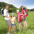 Family rambling in country field — Stock Photo #18210901
