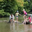 Stock Photo: Family crossing river in summer