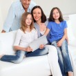 Parents and children using electronic tablet at home — Foto de Stock