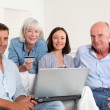 Senior with couple doing shopping online — Stock Photo #18211185