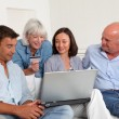 Senior with couple doing shopping online — Stock Photo #18211187