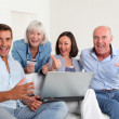 Stock Photo: Senior with couple doing shopping online
