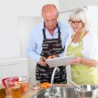 Senior couple preparing apricot jam — Stock Photo