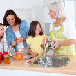 Stock Photo: Portrait of grandmother, mother and kids in kitchen