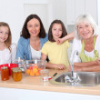 Portrait of grandmother, mother and kids in kitchen — Foto de Stock