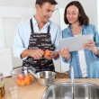 Couple cooking fruit jam at home — Stock Photo