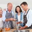 Family preparing fruit jam in home kitchen — Stock Photo #18211295