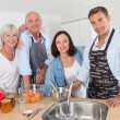 Family preparing fruit jam in home kitchen — Stock Photo