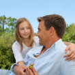 Father and daughter sitting in park — Stock Photo