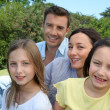 Stock Photo: Portrait of family sitting in park