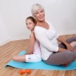 Grandmother and young girl doing fitness exercises — Stock Photo