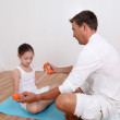 Man helping young girl with fitness exercises — Stock Photo #18211439