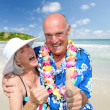 Happy senior couple at tropical beach — Stock Photo