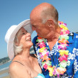 Stock Photo: Happy senior couple at tropical beach