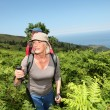 Senior couple hiking in natural landscape — Stock Photo