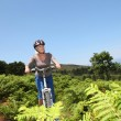 Stock Photo: Senior womriding mountain bike