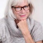 Portrait of smiling senior woman with eyeglasses — Stock Photo #18212761