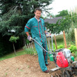 Gardener using motorized cultivator - 图库照片