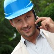 Entrepreneur talking on mobile phone — Stock Photo