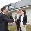 Royalty-Free Stock Photo: Real-estate agent with senior couple buying new house