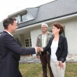 Real-estate agent with senior couple buying new house — Stock Photo #18213987
