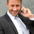 Portrait of handsome businessman talking on mobile phone — Stock Photo #18214057