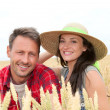 Stock Photo: Portrait of happy couple in wheat field