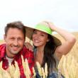 Portrait of happy couple in wheat field — Stock Photo