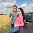 Couple standing by convertible car  — Stock Photo