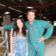 Stock Photo: Couple of breeders standing in barn