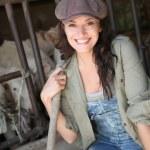 Portrait of smiling farmer in barn — Stock Photo