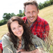 Stock Photo: Happy couple laying down meadow