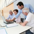 Group of senior attending job search meeting - Stock Photo