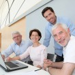 Group of senior attending job search meeting - Foto Stock