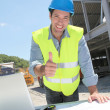 Happy worker on construction site  — Stock Photo