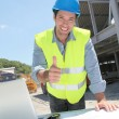 Stock Photo: Happy worker on construction site
